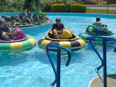group of adults enjoying bumper boat rides